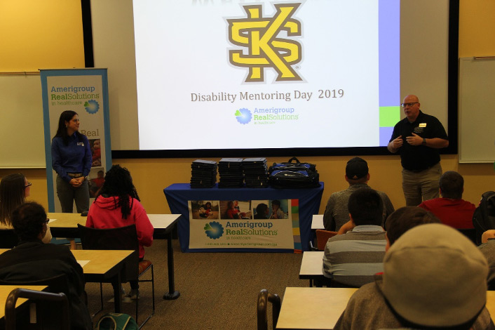 A person presenting the Disability Mentoring Day to an audience.